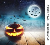 halloween pumpkin in a dark... | Shutterstock . vector #496748569