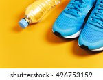 Blue Sneakers And Bottle Of...