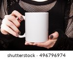 girl in black dress is holding... | Shutterstock . vector #496796974