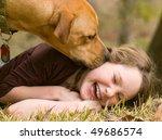 Dog Making Girl Laugh On Grass
