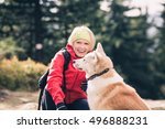 woman hiking with akita inu dog ... | Shutterstock . vector #496888231