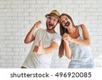 funny couple holding paper... | Shutterstock . vector #496920085