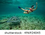 girl snorkeling with a stingray ... | Shutterstock . vector #496924045