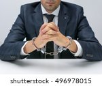 businessman with handcuffs   Shutterstock . vector #496978015