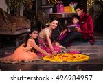 indian young family making... | Shutterstock . vector #496984957