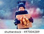 adorable kid with big gift box... | Shutterstock . vector #497004289