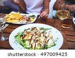 dinner at restaurant. close up... | Shutterstock . vector #497009425