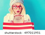 happy young woman holding... | Shutterstock . vector #497011951