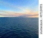 Small photo of Seascape with a setting sun, Gladstone's coast line.