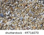 A closeup background shutoff pebbles on the beach. - stock photo
