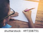 schoolboy's hands with pencil... | Shutterstock . vector #497208751