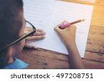 schoolboy's hands with pencil... | Shutterstock . vector #497208751