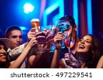 Stock photo group of young friendly people toasting in night club or bar 497229541