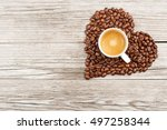 Coffee Cup In A Heart Of Beans...