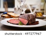 entrecote with grilled garlic... | Shutterstock . vector #497277967