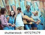 happy friends playing guitar... | Shutterstock . vector #497279179
