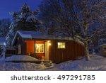 snowed up wooden cabin on a... | Shutterstock . vector #497291785