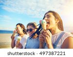 three young woman eating ice... | Shutterstock . vector #497387221