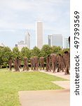 Small photo of CHICAGO, ILLINOIS - SEPTEMBER 14, 2016: Agora by Magdalena Abakanowicz in the south end of Grant Park, Chicago, stand 106 headless figures.