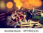 group of four friends hanging... | Shutterstock . vector #497402131