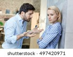 sulky woman  explaining man at... | Shutterstock . vector #497420971