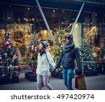 Young Couple Doing Christmas...