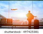 Small photo of happy traveler waiting for the flight in airport, departure terminal, immigration concept