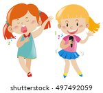 two girl singing and dancing... | Shutterstock .eps vector #497492059