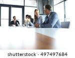 young businesswoman talking... | Shutterstock . vector #497497684