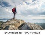 tourist on the peak of high... | Shutterstock . vector #497499535