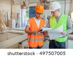two carpenters are analyzing... | Shutterstock . vector #497507005