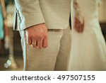Small photo of Detail of a man's hands fidgeting with a wedding ring
