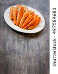 honey glazed baby carrots with... | Shutterstock . vector #497584681
