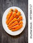 honey glazed baby carrots with... | Shutterstock . vector #497584717