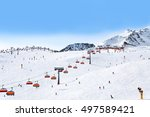 Skiers And Chairlifts In Alpin...