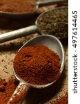 Small photo of macro closeup paprika in pewter spoon