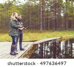 fisherman with a spinning rod... | Shutterstock . vector #497636497