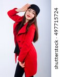 the girl flaunts in a coat | Shutterstock . vector #497715724