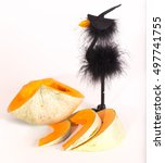 The Cut Pumpkin And Toy Crow I...