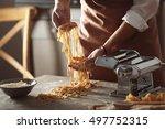 man preparing pasta on kitchen... | Shutterstock . vector #497752315