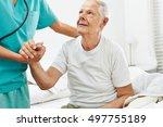 geriatric caregiver helping old ... | Shutterstock . vector #497755189