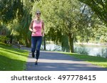 shot of a beautiful fit runner... | Shutterstock . vector #497778415