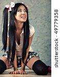 Young beautiful japanese woman. On wall background. - stock photo