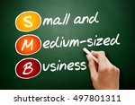 Small photo of Hand drawn SMB - Small and Medium-Sized Business, acronym business concept on blackboard
