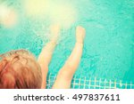 baby sitting near swimming pool. | Shutterstock . vector #497837611
