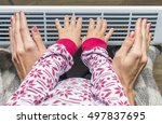woman and child warm up hands... | Shutterstock . vector #497837695