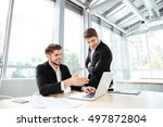 two happy young businessmen... | Shutterstock . vector #497872804