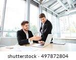 two happy young businessmen... | Shutterstock . vector #497872804