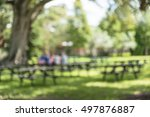 Blurred Image Of Picnic Tables...