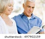 nice elderly couple sitting... | Shutterstock . vector #497902159